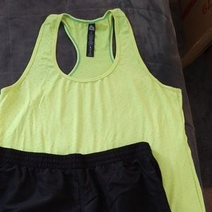 Black shorts and yellow tank top size extra large
